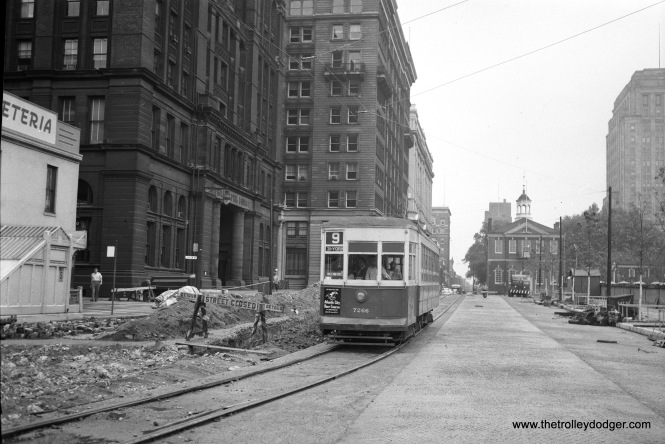 "Philadelphia Transportation Company 7266 is on Route 9, sometime in the 1950s during street construction. Micheal T. Greene writes: ""The Route 9 car is on 5th Street south of Market Street. At this time, 5th Street was being widened as part of Independence Mall. Independence Hall is out of this picture to the right."""