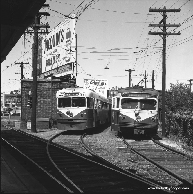 "Philadelphia Suburban Transportation Company (aka ""Red Arrow"") cars 5 and 14 pose at 69th Street Terminal on June 22, 1963. The car at left is a Brilliner, from the last batch of trolleys built by Brill in 1941. The car at right was built by the St. Louis Car Company in 949. Although it looks much like a PCC, it was not considered such as it had standard interurban trucks and motors. Both types of cars were double-ended."