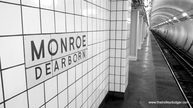 Redone tile at the Monroe and Dearborn CTA Blue Line subway station, showing how an original sign was incorporated into a newer design, May 25, 2018. (David Sadowski Photo)