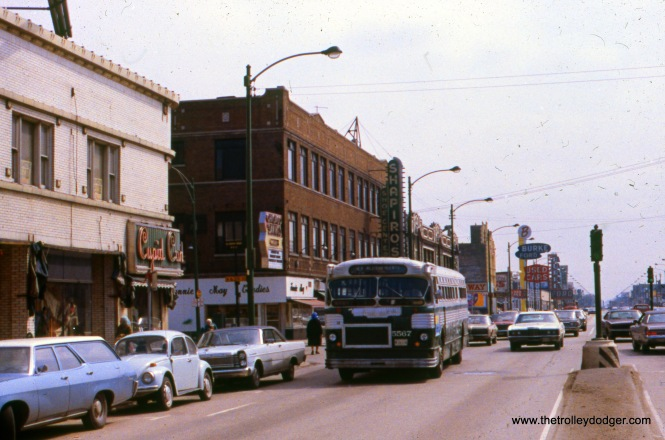"CTA 5567 is on Western near 63rd Street on April 20, 1972 (Route 49). Our resident south side expert M. E. adds, ""Notice Cupid Candies on one corner and Fannie May Candies across the street."" Jeff Weiner adds, ""CTA 5567 appears to be at Western and 62nd, as the City maintained a traffic signal there for the Sears store. Until a closed-loop system was installed, the 62nd signal operated fixed-time during store hours, and went on yellow-red flash when the store was closed. After it was modernized, the operation was semiactuated, with coordination to the other signals on Western. Until it was modernized, the median signals were on concrete ""blockbuster"" foundations, replaced with mast arm signals afterwards."""
