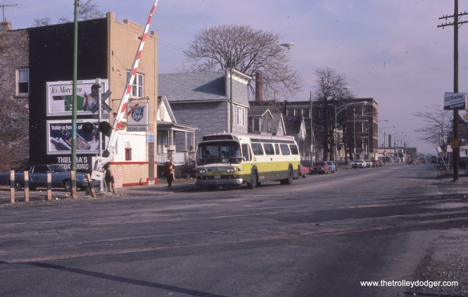 CTA bus 1112 is at 115th and Perry in February 1983.