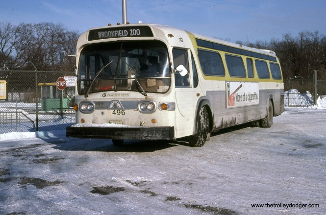 "RTA bus 496 is at the Brookfield Zoo on December 11, 1977. Andre Kristopans adds, ""Bus 496 is on an OSA (Omnibus Society of America) charter. Note the ""9"" covered with tape."" (John Le Beau Photo)"