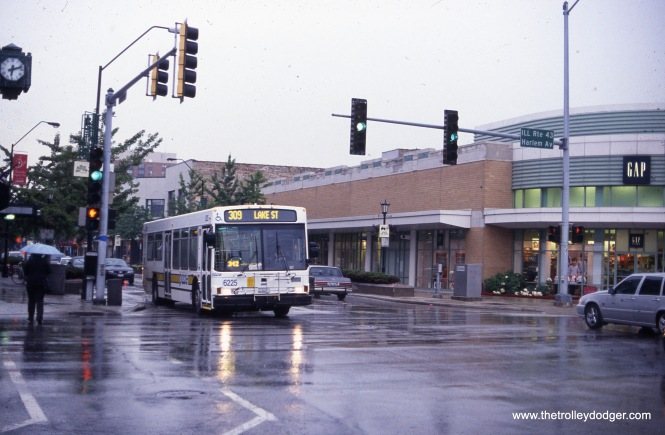 "PACE 6225 heads west on Route 309 - Lake Street at Harlem Avenue. To the left, just out of view, is the former Marshall Field's store in Oak Park, a local landmark. It later housed a Border's bookstore, now also gone. This photo must have been taken a few years ago, as you would see some new tall buildings if you took the same picture today. Unable to move outward, Oak Park is moving ""up."" (John Le Beau Photo)"