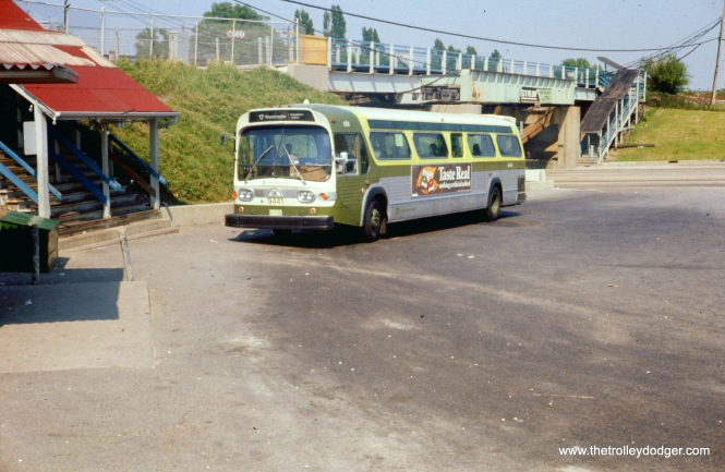 "CTA ""New Look"" bus 9441, running on Route 17 - Westchester, is at the DesPlaines terminal on June 28, 1977. Since the previous picture was taken, the set of stairs on the west side of DesPlaines Avenue has been removed. Since the other stair still appears to be in use, it seems as though the CTA decided to extend the walkway to the platform area, so that commuters would not need to go up and down so many stairs."