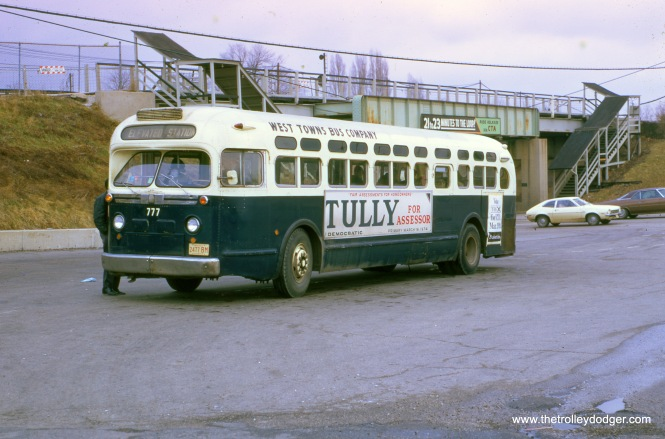 Chicago & West Towns bus 777 at the CTA DesPlaines Avenue terminal on March 17, 1974. The terminal has since been redone. The two sets of stairs on DesPlaines Avenue appear to provide a way for pedestrians to cross a busy street where there are no stoplights. (John Le Beau Photo)