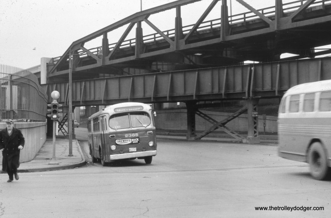 CTA 2365 is operating on Route 58 - Ogden at 26th and Cicero Avenue in the late 1950s.