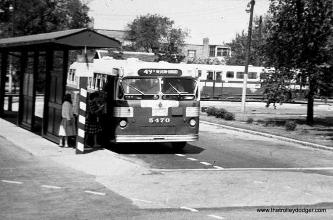 Passengers board CTA bus 5470 at the Western and Berwyn loop on Chicago's north side. Route 49B was the northern extension of the Western line.
