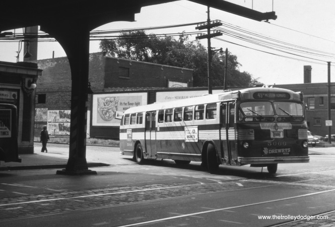 "CTA bus 5066 is turning north from Leland onto Western, running Route 49B in 1958. Here, riders could change to the Ravenswood ""L"", today's Brown Line. The station has since been rebuilt. Jeff Wien adds, ""I believe that the photo of CTA 5066 at Western & Leland was taken in 1956 rather than 1958 as stated in the caption. Route 49 was converted to motor bus in June 1956. The photo shows the streetcar tracks still exposed as well as the overhead wires in place. I would imagine that the wires would have been removed by 1958, and I seem to recall that the City paved Western Avenue not long after the streetcars were removed. The City built the obnoxious overpass at Western and Belmont shortly after the streetcars were removed in 1956."""