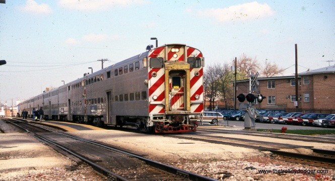 A Metra train stops at the Mont Clare station on the former Milwaukee Road West Line on April 13, 1999. The original station at this location was demolished in 1964, and my father and I sifted through the rubble. We found several tickets, some dating back to the 1880s, which we donated to a local historical society. As far as I know, these are still on display at the Elmwood Park Public Library.