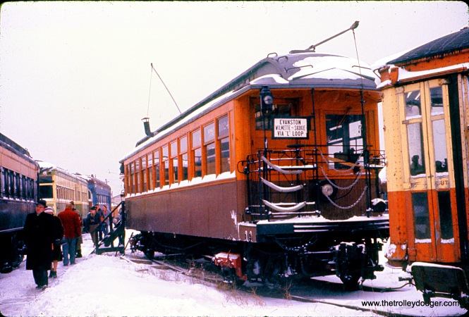 "CTA wooden ""L"" car 1024 at the Illinois Electric Railway Museum in North Chicago, February 1960. The original museum location was at the Chicago Hardware Foundry Company, adjacent to the North Shore Line tracks. Some of the wooden ""L"" cars were operated under their own power to North Chicago. This car, originally built by Pullman in 1898 as Northwestern Elevated Railroad 24, has since been restored to its original condition at IRM in Union."