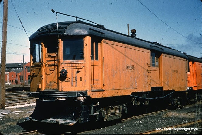 "Don's Rail Photos says that North Shore Line car 231 ""was built by Cincinnati in May 1924, #2720, as a merchandise despatch car. It was rebuilt as a plow in 1949."" That's the configuration we see it in here. It does not appear to have been saved."
