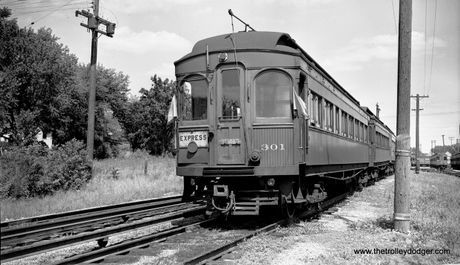 "Chicago Aurora & Elgin wood car 301 at the Wheaton Yards on July 8, 1955. Don's Rail Photos: ""301 was built by Niles Car & Mfg Co in 1906. It was modernized in December 1940."" As part of this modernization, the car's stained glass windows were covered up. Unfortunately, this car was not saved."