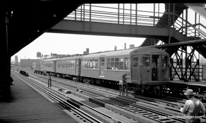 "This three-car train of Chicago Transit Authority 4000-series ""L"" cars is signed as a Howard Street Express in June 1949. (L. L. Bonney Photo) Our resident south side expert M. E. adds, ""Methinks this photo was taken looking west at the Indiana Av. (at 40th St.) station. Because the train destination sign says Howard Express, the location has to be on the main north/south line. (Plus, this train had to originate on the Jackson Park branch, because Englewood trains at that time ran to Ravenswood.) Also, I don't recall any other three-track main anywhere else on the north/south line. Also, Indiana Ave. had the overhead walkway to get to and from the Stock Yards L, which terminated to the left of the left-hand platform in the photo. When this photo was taken, the Kenwood L ran as through service from 42nd Place, through Indiana Ave., up to Wilson Ave. Later in 1949, the Kenwood service was cut back to a shuttle ending at Indiana Ave. The inbound station platform was extended over the northernmost track, then mainline north/south service used the middle track heading downtown. A fuller explanation is at https://www.chicago-l.org/operations/lines/kenwood.html . Also of interest is that this photo shows a three-car train. Before the advent of new equipment in 1950 there were no ""married pairs"" of cars. Trains could be as small as a single car, which I recall seeing on the Englewood branch on Sunday mornings. Plus, the three-car train shown in the photo would have had two conductors whose job was to open the passenger entry doors (which were on the sides, at the ends of the cars) using controls situated between the cars. So conductor #1 operated the doors at the rear of car 1 and the front of car 2. Conductor #2 operated the doors at the rear of car 2 and the front of car 3. Side doors at the front of car 1 and the rear of car 3 were not used by passengers. To operate his side doors, a conductor had to stand between the cars. (Yes, in any weather.) And the conductors had to notify the motorman when to proceed. To do this, the conductors had to observe when there was no more boarding or alighting at their doors. They used a bell system to notify the motorman. Two dings meant ""proceed"". One ding meant ""hold"". The rearmost conductor started with his bell, then the next rearmost, etc., until two dings rang in the motorman's compartment, his signal to go. The longer the train, the longer it took to leave the station."""