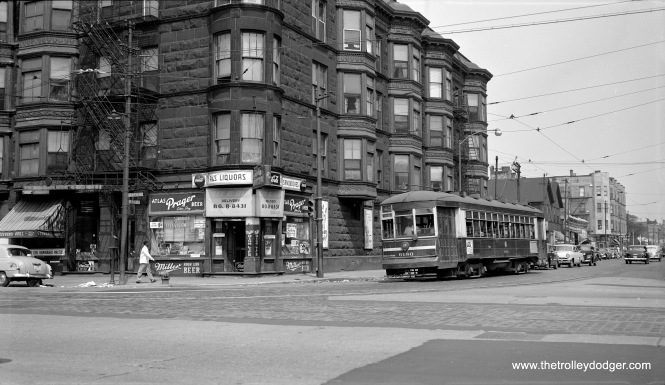 "The late photographer Robert Selle writes, ""CTA one-man car 6180 turning north onto State Street from 43rd Street (43rd Street line), August 1, 1953."""