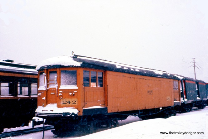 "Don's Rail Photos says, (North Shore Line) ""213 was built by Cincinnati in March 1920, #2445, as a merchandise despatch car. In 1940 it was rebuilt as a disc harrow ice cutter. It was retired in 1955 and sold to CHF as their 242. It was donated to Illinois Railway Museum in 1964."" Here, we see the car at the Chicago Hardware Foundry Company in February 1960. This was also then the location of the Illinois Electric Railway Museum."