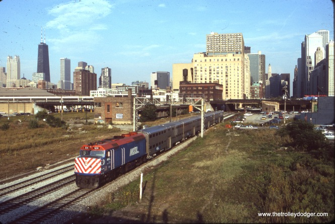 Metra Milwaukee District loco 124 is pushing an eastbound train towards Union Station in Chicago. The view looks east from DesPlaines Street. August 1995. (Dan Munson Photo)