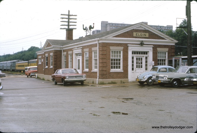"The Milwaukee Road's Elgin terminal in August 1970. Bill Shapotkin adds, ""The MILW depot in Elgin was built 1948. It is the second depot constructed at the same site. View looks south from Chicago St."""
