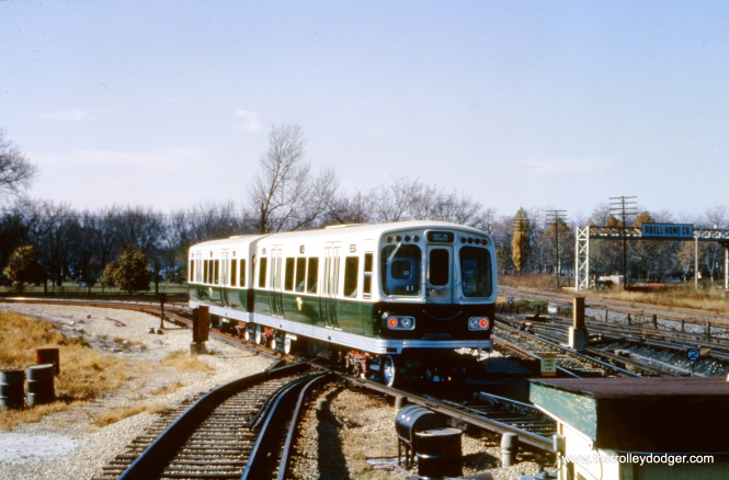 CTA 2029-2030 on the turnaround loop at the DesPlaines Avenue terminal in October 1964. We are looking west. Here, you can see the close proximity of the Chicago Great Western tracks to the right. These have since been removed, and the area turned into a bike path connecting with the Illinois Prairie Path at First Avenue in Maywood.