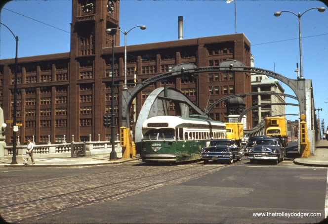 CTA PCC 4396, a product of the St. Louis Car Company, is southbound on Clark Street, having just crossed the Chicago River, on July 9, 1957. This is from an original 35mm Kodachrome slide, processed by Technicolor.