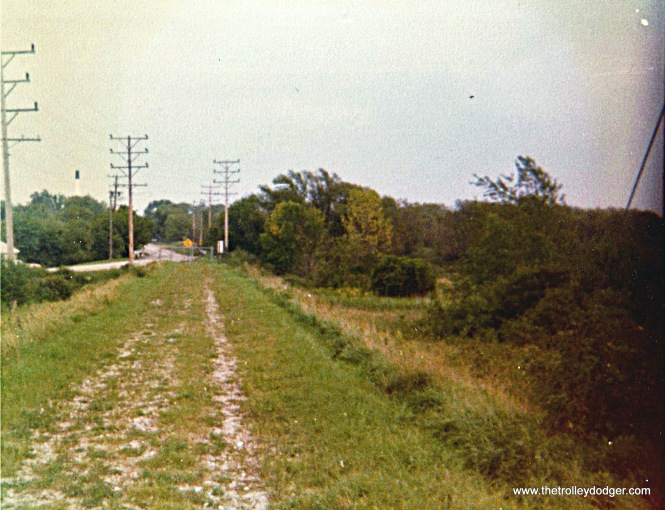 TM r.o.w. entering street on west side of Oconomoc, looking east in 1976.
