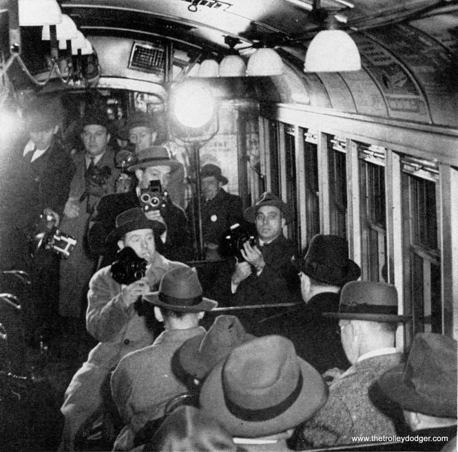 Mayor Kelly on the ceremonial train, surrounded by reporters.