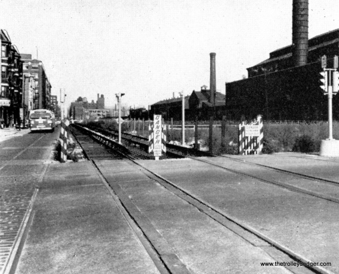 The Garfiled Park temporary tracks in the south half of Van Buren Street. The old Throop Street shops are at right.