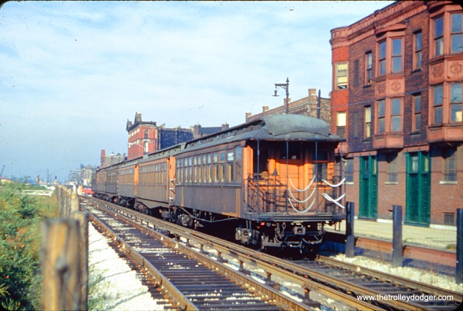"This photo is interesting, as it shows a 6-car train of old wooden ""L"" cars on the CTA's temporary Garfield Park ""L"" trackage in Van Buren Street, possibly before service was transferred there in September 1953."