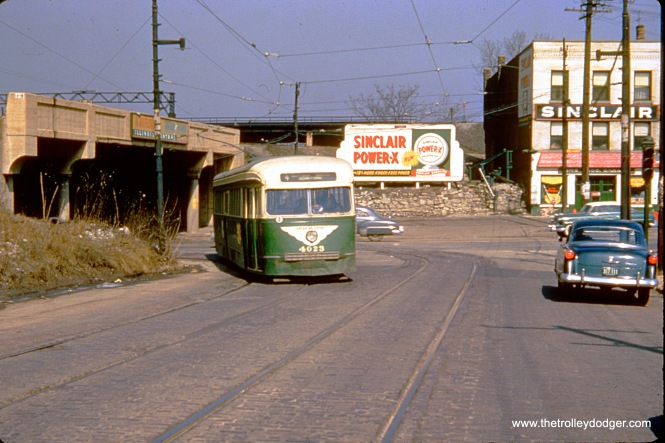 CTA prewar PCC 4023 is northbound on Route 4 - Cottage Grove circa 1952-55, having just crossed under the Illinois Central tracks.