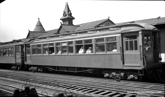 "CTA 3164 is at the Hamlin station on the Lake Street ""L"" in August 1948."