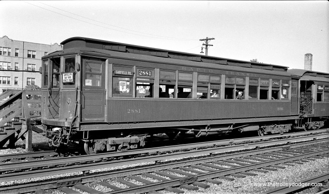 "CRT 2881 is at Gunderson Avenue (in suburban Oak Park), one of the ground-level stations on the Garfield Park ""L"", on September 19, 1934. This location is now the site of I-290, the Eisenhower Expressway."