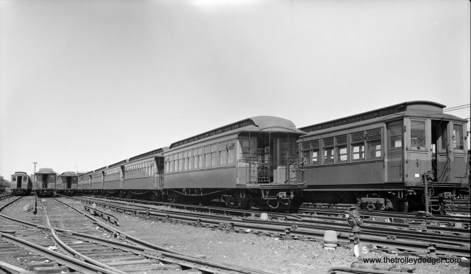 "CTA gate cars and Met cars are on display at Laramie Yard in this August 1948 view (on the Garfield Park ""L"")."
