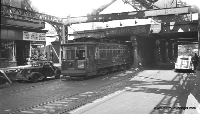 "CSL 5395 is westbound on 6rd Street at the Illinois Central underpass, east of Dorchester, on June 13, 1947. The ""L"" has since been cut back to a point west of here at Cottage Grove. Its eventual destination will be Oak Park Avenue."