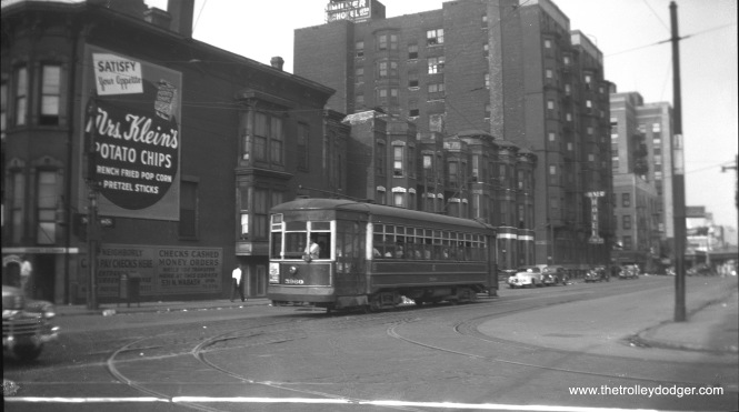 CSL 5960 is westbound on Grand Avenue at Wabash on August 21, 1947.
