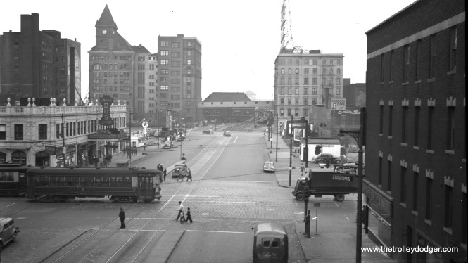 CSL 5814 is southbound on Wabash at Roosevelt Road on June 13, 1947. In the background, you can see how Roosevelt Road streetcars crossed over the Illinois Central tracks (and around Central Station) to reach the Field Museum and Soldier Field. This extension was built for the 1933-34 A Century of Progress world's fair.
