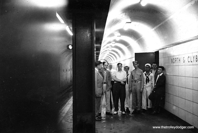 On July 25, 1943 several railfans posed on the northbound platform of the as-yet unopened State Street Subway station at North and Clybourn. From left to right, we have John Goehst, O. Scheer, George Krambles, N. Strodte, John R. Williams, J. E. Merriken Jr., R. Burns, J. Hughes, and R. E. Geis. (William Shapotkin Collection)