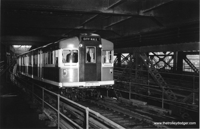 "A Brooklyn-Manhattan Transit articulated ""Bluebird"" set of cars, on its inaugural run in 1939."