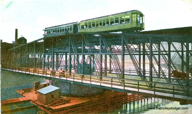 A colorized postcard view of a two-car Lake Street train crossing the Chicago River in the early 1900s. The postcard itself was mailed in 1907.
