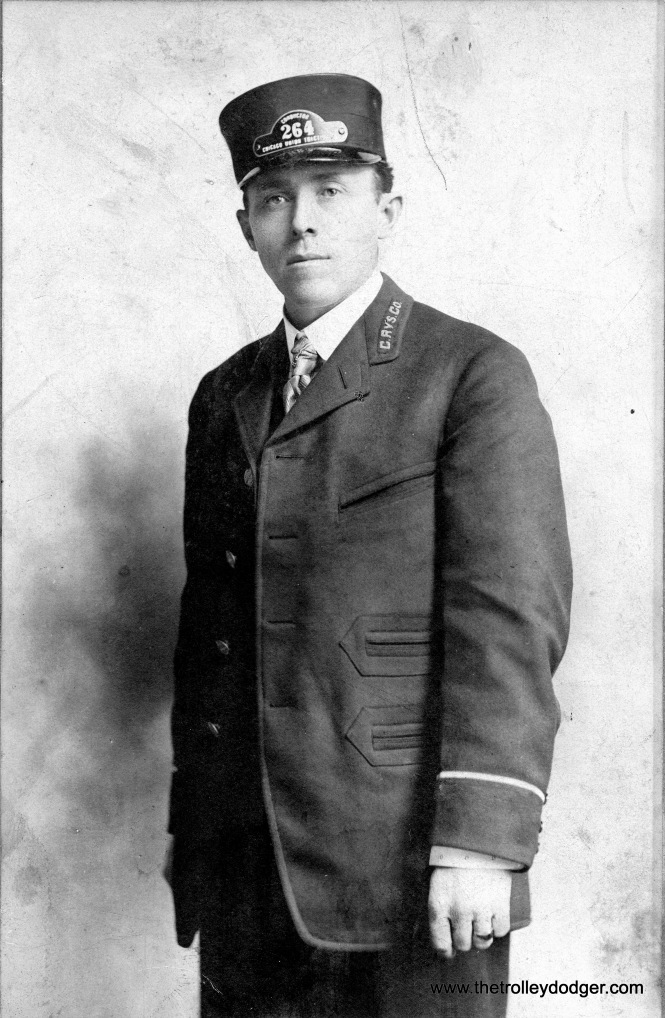 This transit worker is wearing a Chicago Union Traction cap, and a Chicago Railways jacket. This may help date the photo, as Chicago Railways acquired Chicago Union Traction in 1908.
