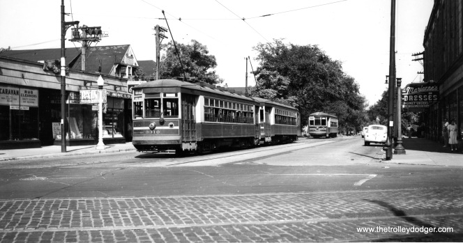 "CSL 3210 on Montrose at Milwaukee, west end of the line. Streetcars were replaced by buses on July 29, 1946. Trolley buses ran west o here. The entire line was converted to trolley bus on April 19, 1948, and they continued in used until January 13, 1973. Jim Huffman adds, ""car #3310 is behind the car waiting to go east. This was always a problem with PM pull-out trippers at the end of line crossovers. The regular cars would have a longer layover/recovery time than the pull-outs would have. Often the tripper would arrive after their follower, hence the follower at the extreme end with its leader squeezed in so as to leave first. If two followers were there first, one would have to take the crossover & back up on the adjacent track. This I learned from observation when I was younger & also from CSL family members. Buses do not have this problem, they just go around."" (Joe L. Diaz Photo)"