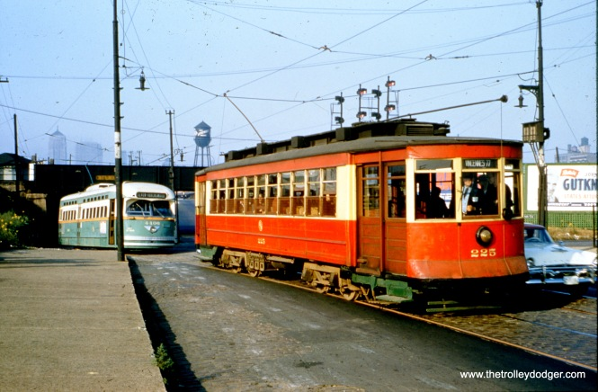"CTA red Pullman 225 and PCC 4406 on an October 21, 1956 fantrip. M. E. adds, ""This picture is at 16th and Clark, facing north. Streetcars had their own private right-of-way west of Clark going under the two railroad viaducts located here."""