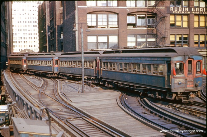 A train of CA&E woods near Wells Street Terminal in downtown Chicago.