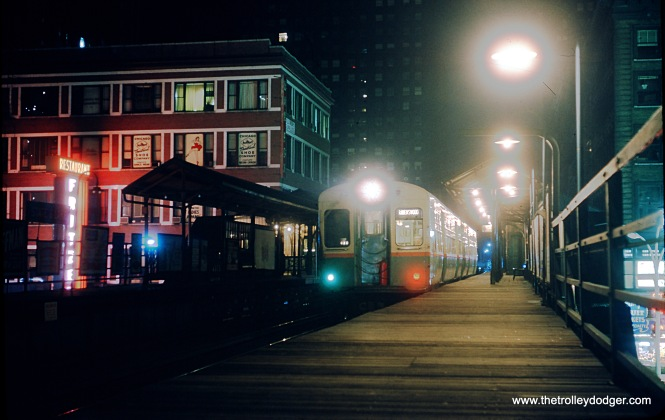 "A Ravenswood ""L"" train at State and Lake in April 1964. Trains ran counter-clockwise around the Loop in one direction until the opening of the Dan Ryan line in 1969. Fritzel's restaurant is at left. At right, you can just make out one of those ""praying mantis"" street lights, installed in 1959. Steve Felsenthal adds, ""Ravenswood trains switched to the inner track after stopping on the outer track at Randolph & Wells except during weekdays rush hours during the CTA era from sometime in the early to mid 50s until 1969 when the direction of the inner loop track was reversed."""