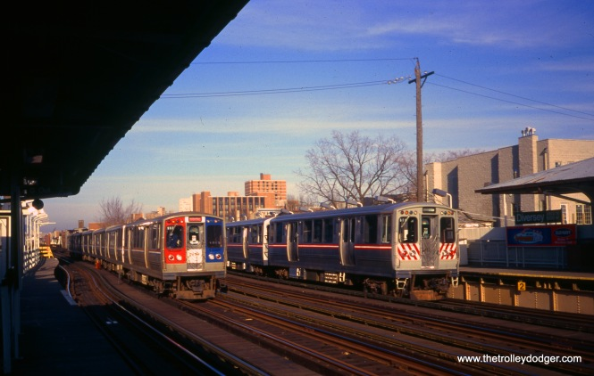 "At right, 2411-2412 are on the same fantrip mentioned in the revious photo. At left, a southbound Howard-Dan Ryan train passes the Diversey station on the Ravenswood ""L"". William Shapotkin took this picture on December 13, 1998."
