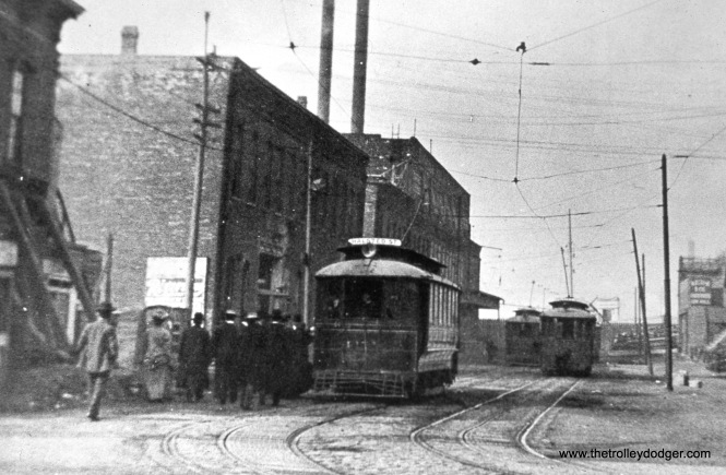 Chicago, IL. Looking westbound on O'Neil Street (now 23rd Place) from Halsted Street. Well into the 1900s, this was an important terminal/transfer point. Note cable slots-- the West Chicago Street Railroad Company's Halsted-Van Buren cable line terminated in the carbarn at left. This was also the south terminal of Chicago Union Traction's Halsted line. CUT car #4171 (Pullman 1898) prepares for its northward journey. (Fred J. Borchert Photo)