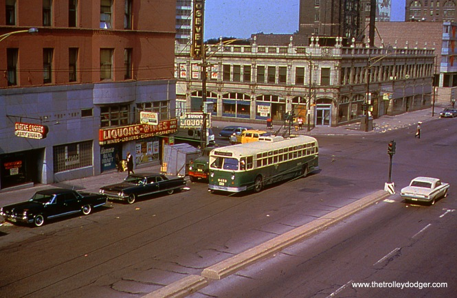 CTA trolley bus 9453, working a westbound trip on Route 12 - Roosevelt Road, has just crossed Wabash Avenue. (The building on the northeast corner is the one-time Union Bus Depot.) The view looks northeast on May 27, 1967, taken from the CTA Roosevelt Road station.) Jeffrey L. Wien Photo, Wien-Criss Archive)