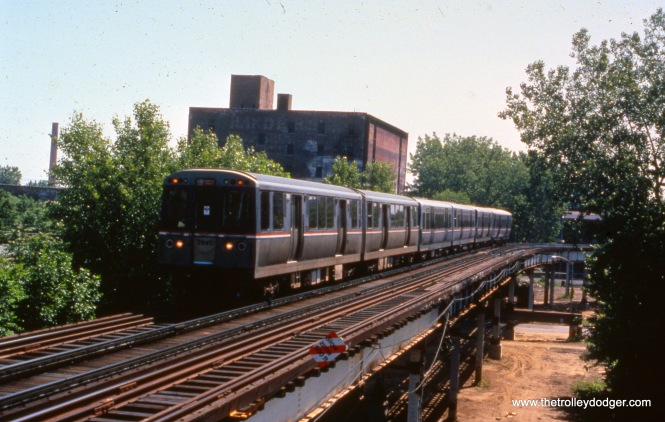 "A northbound CTA train approaches the Indiana ""L"" station on the south side of Chicago on June 28, 1992. The occasion was a Central Electric Railfans' Association fantrip, celebrating a century of rapid transit. (Jim Arvites Photo)"