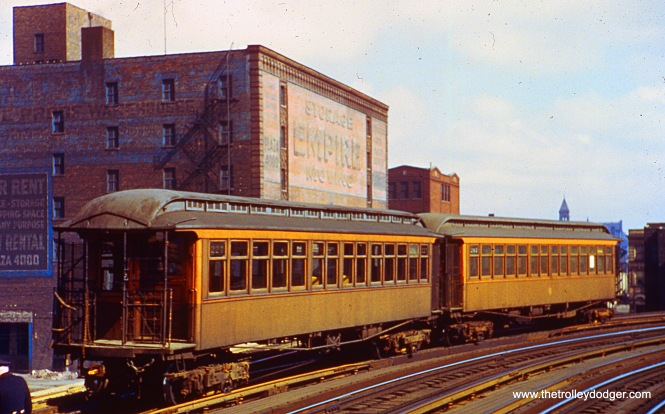 "A two-car train, including #227, is being stored for Kenwood service, on what had once been the northbound local track on the South Side ""L"", in the early 1950s."