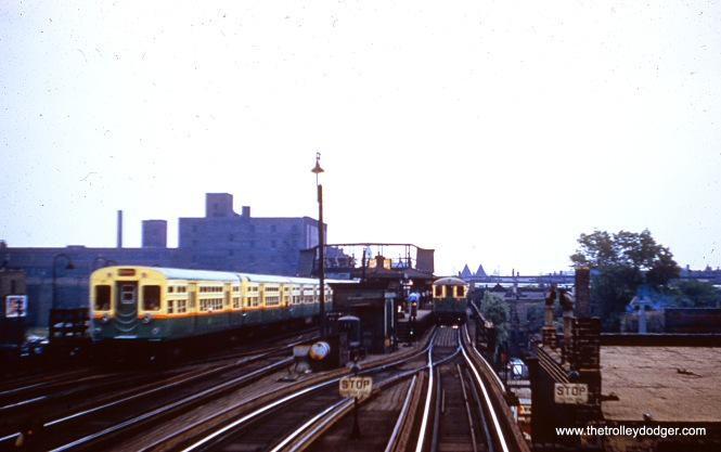 "The Indiana Avenue station on the South Side ""L"" circa 1956. A northbound Englewood-Howard train departs the station, while a Stockyards shuttle train awaits departure time. The view looks east. (Joseph N. Canfield Photo)"