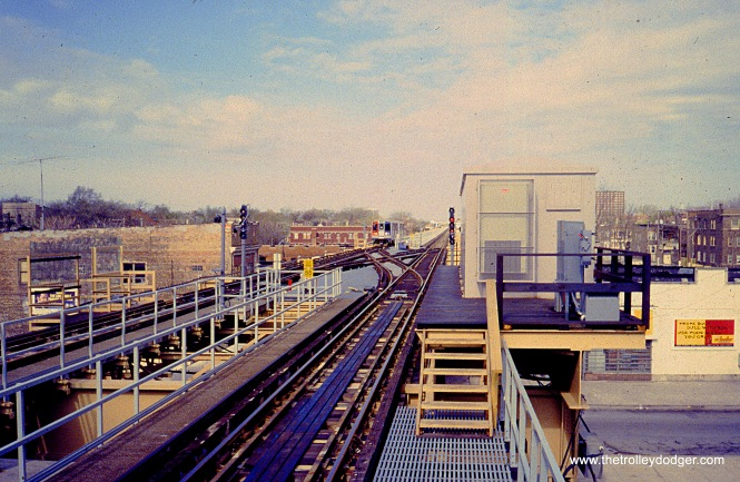 A southbound Jackson Park train approaches 63rd and Cottage Grove on May 12, 1996. The train is about to cross over and arrive at the station. The view looks west (timetable north) from the north platform. (William Shapotkin Photo)