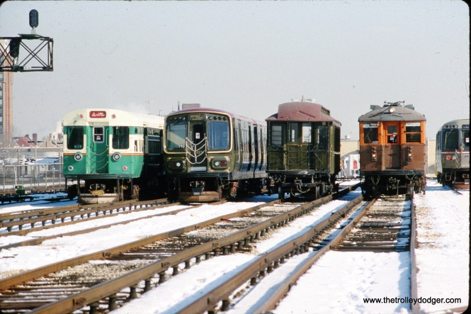 Four generations of Chicago rapid transit cars, as they were posed in Forest Park on January 9, 1994-- cars 6102, 1992 (formerly 2008), 1, and 4271. After this, their fates diverged; car 1 is now at the Chicago History Museum, 1992 eventually went to the Illinois Railway Museum for parts scrapping, 4271 is still part of the CTA's Heritage Fleet, and 6102 was stored at the Fox River Trolley Museum for several years, before returning to CTA in 2017, where it will hopefully one day run again. (Bruce C. Nelson Photo)